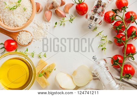 Raw rice and ingredients for cooking risotto. Horizontal permission. White background. Top view.