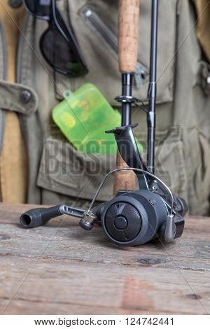 Fishing Tackles With Fishing Vest And Wooden