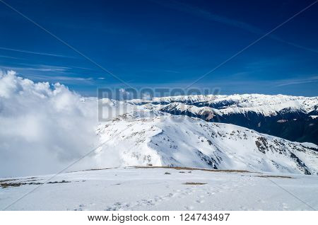 Winter landscape in the mountains. Mountain ridges covered by snow in winter in Europe.