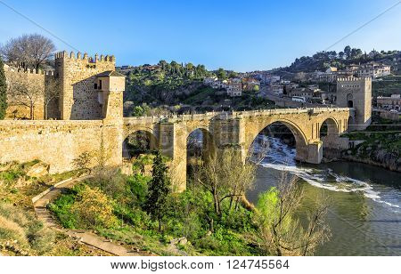 Puente De San Martin Bridge Over The Tajo River In Toledo, Spain
