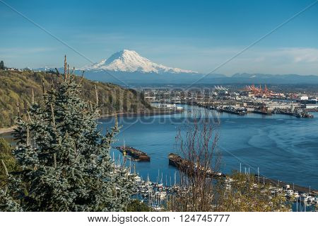 A panoramic view of Mount Rainier The Port of Tacoma and a marina.