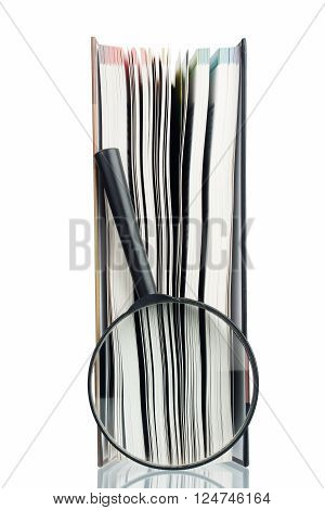 Magnifying glass and book, isolated on white background