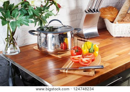 tomatoes on a wooden board knife kitchen countertops, interior, pan, hob, cooker, cooking