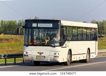 MOSCOW RUSSIA - MAY 9 2013: White suburban bus MAN A74 Lion's Classic at the intercity road.