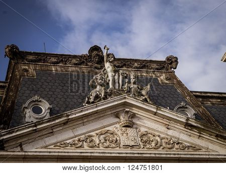 Statue on a roof  in the city of Lisbon