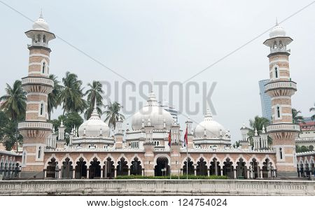 Kuala Lumpur,Malaysia - September 29, 2014: Tourists can seen exploring around the Masjid Jamek mosque which is located at the heart of Kuala Lumpur city.