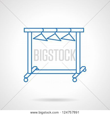 Laundry and household equipment. Rach with three hangers for dresses and clothes. Furniture for fashion industry. Flat blue line style vector icon. Single design element for website, business.