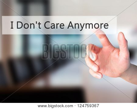 I Don't Care Anymore - Hand Pressing A Button On Blurred Background Concept On Visual Screen.