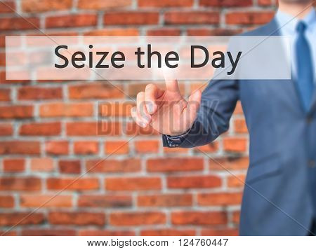 Seize The Day - Businessman Hand Pressing Button On Touch Screen Interface.