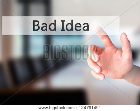 Bad Idea - Hand Pressing A Button On Blurred Background Concept On Visual Screen.