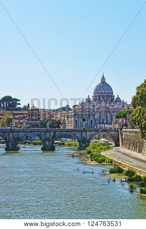 Dome of Saint Peter Basilica and Bridge called the Ponte Sant Angelo in Rome in Italy. The bridge is also called as the Bridge of Hadrian.