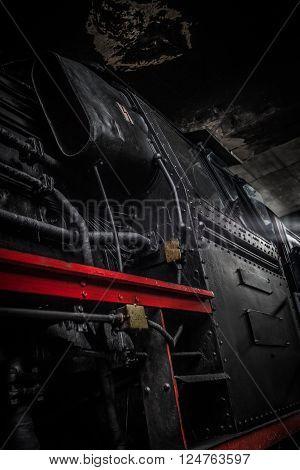 SCHWERIN - GERMANY - FEBRUARY 2015: dark black red striped cabin from a german steam train on february 2015
