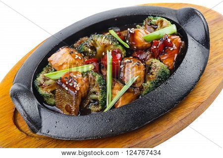 Salmon with vegetables and teriyaki sauce. Isolated on white