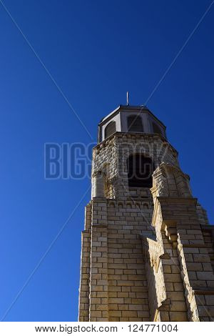 church spire against a blue sky pointing upward
