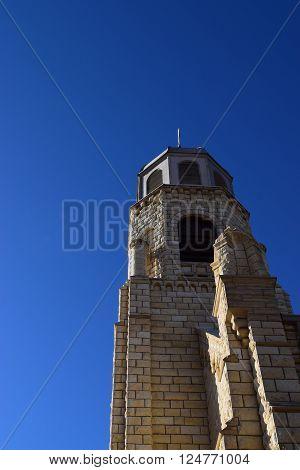 church spire against a blue sky pointing upward