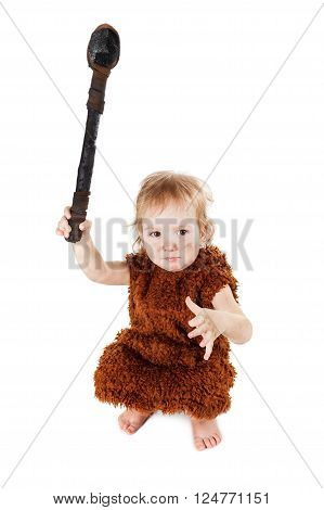 Little funny caveman boy in a suit with a dirty face holding an ax. Humorous concept ancient caveman. Isolated on white.
