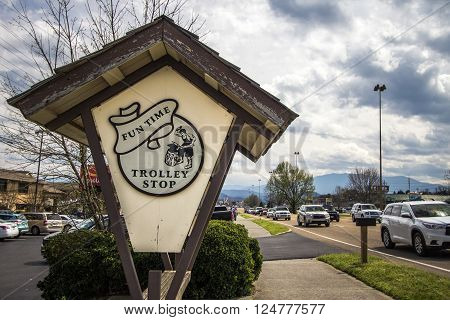 Pigeon Forge, Tennessee, USA - March 26, 2016 - Trolley stop allows visitors to travel between Gatlinburg and Pigeon Forge. The two resort towns receive approximately 12 million visitors annually