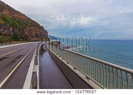 View of the magestic Sea Cliff Bridge and surrounding landscape of Grand Pacific Drive, Sydney, Australia.