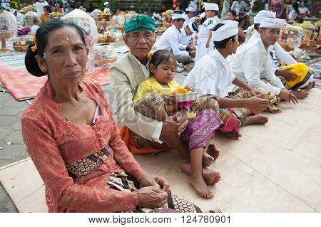 Bali Indonesia Apr 4 2016 : Balinese family in traditional costume attending Meprani Ceremony at tample in Batur. Meprani is one of the Hindu ceremony in Bali Island Indonesia.
