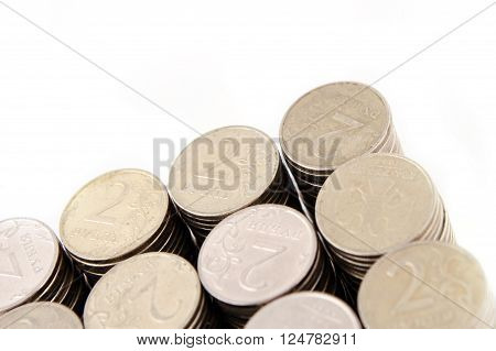 Columns of Russian rubles coins on a white background