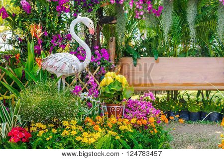 Flamingo  Bird Statue In Flower Garden.