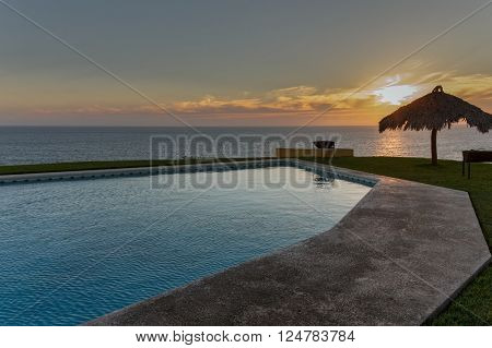 Playa Azul, Mexico - Januaray 30, 2013: Infinity Pool of a resort at the Pacific Ocean in Mexico