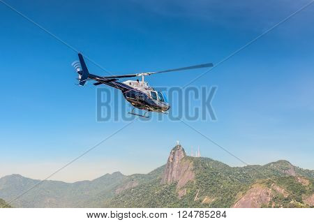Rio de Janeiro, Brazil - December 21, 2012: The Rio de Janeiro Helicopter Tour in Rio de Janeiro, Brazil. Corcovado and Christ the Redeemer statue is seen in the background.