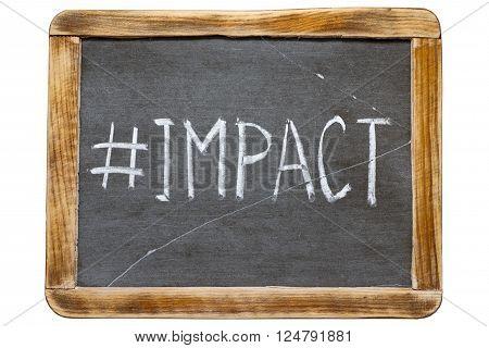 impact hashtag handwritten on vintage school slate board isolated on white