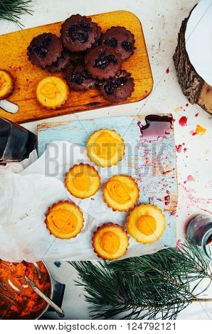 Homemade cupcakes onto an wooden background. Rustic style. Homemade fresh pastries. Food background. Basic Vanilla cupcakes. ** Note: Visible grain at 100%, best at smaller sizes