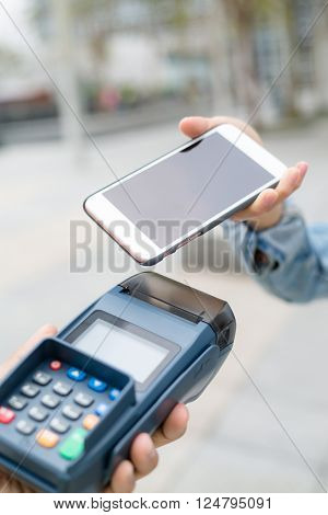 Customer using mobile phone to checkout