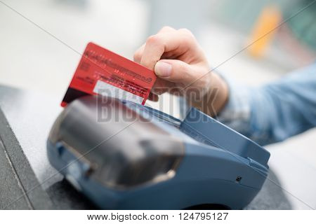 Woman using credit card to pay