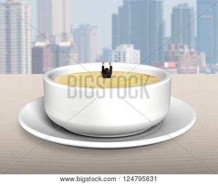Man Hanging On Edge Of Soup Bowl