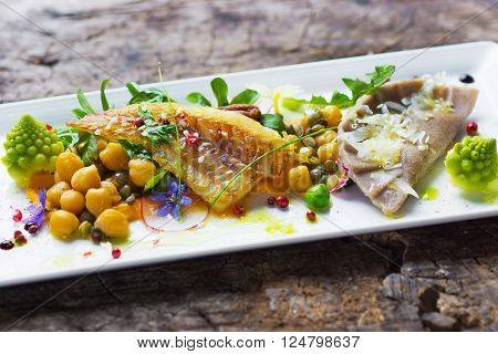 Fish fillet with chickpeas, carrot puree and vegetables