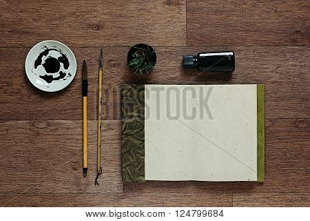 The workplace painter. The resentation. The blank notebook. Background.