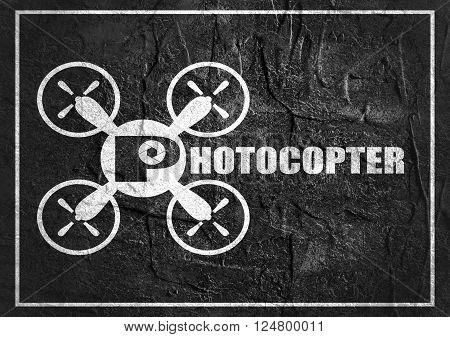Drone quadrocopter icon. Flat symbol. Monochrome image. Photocopter text. Concrete textured