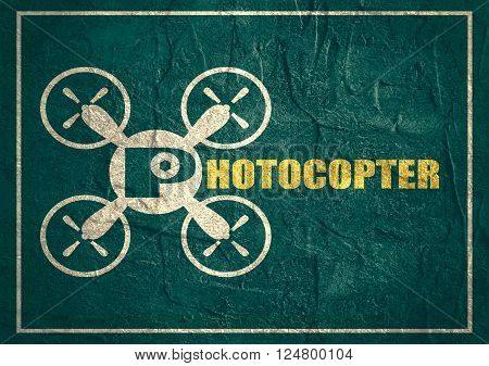 Drone quadrocopter icon. Flat symbol. Concrete textured. Photocopter text