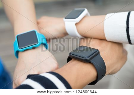 Friends using smart watch together