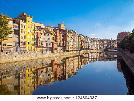 Colorful houses reflected in water, Girona, Catalonia, Spain