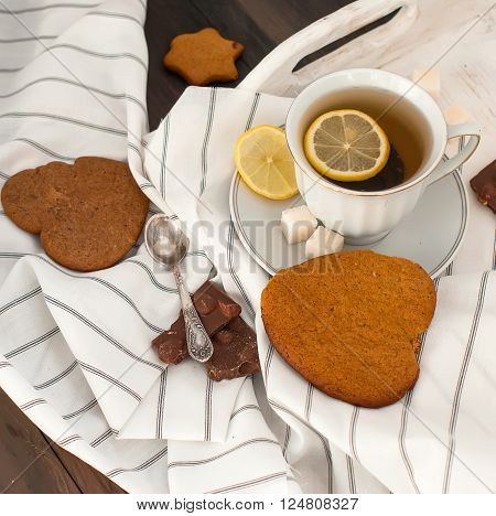 Homemade Cookies And Nuts With A Cup Of Tea