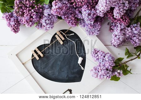 bouquet of beautiful purple lilacs bouquet of lilacs and the words I love lilacs and piston plate for writing with chalk