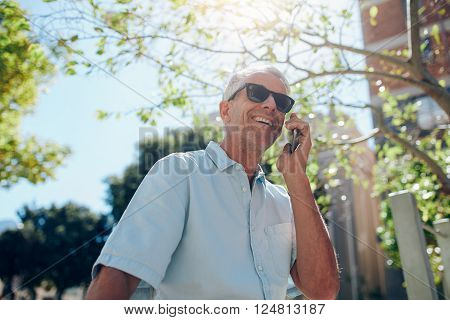 Mature Man Talking On Mobile Phone Outdoors