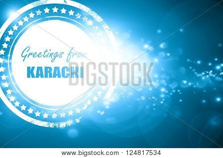 Glittering blue stamp: Greetings from karachi with some smooth lines