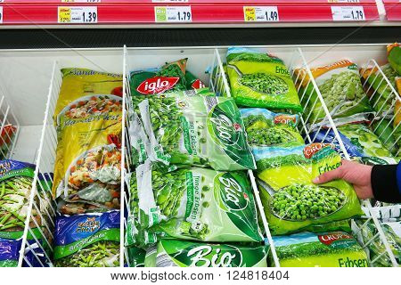 MEPPEN, GERMANY - MARCH 2, 2016: Food Packages in Freezer. Various frozen Vegetables packings in a Kaufland Hypermarket.