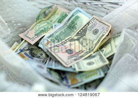 A collection of various american dollar banknotes. Many different currencies as colorful background concept