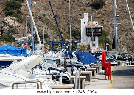 MARINA DEL ESTE, SPAIN - JUNE 10, 2008 - Boats moored in the marina with the harbour masters office to the rear Marina del Este Malaga Province Andalusia Spain Western Europe, June 10, 2008.