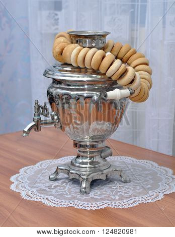 Standing on the table Russian samovar and a bunch of bagels