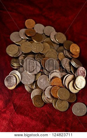 A lot of Russian coins on a background of red suede ** Note: Visible grain at 100%, best at smaller sizes