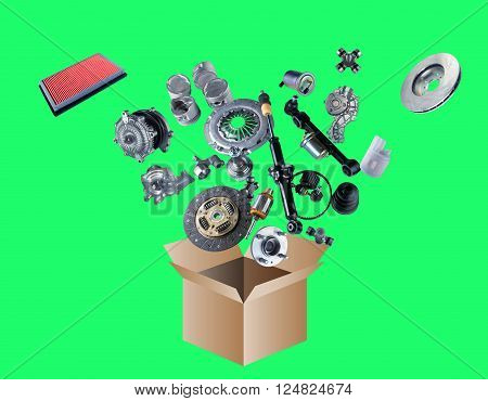 Many spare parts flying out of the box isolated on green screen, chroma key
