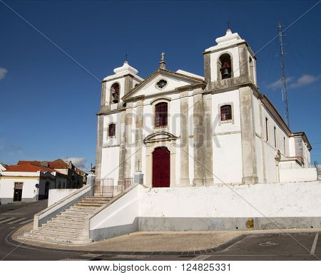 Old Sao Pedro Church facade and staircase in Palmela under a blue dark sky. Setubal Portugal.