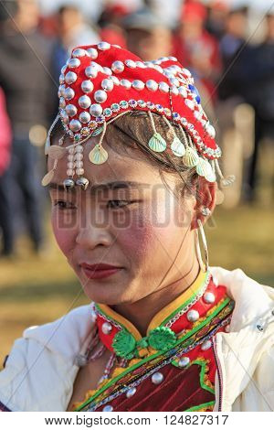 Heqing, China - March 15, 2016: Chinese Woman In Ancient Chinese Clothing During The Heqing Qifeng P